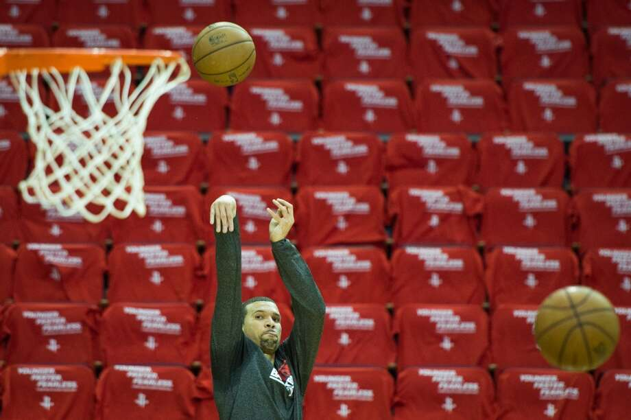 Rockets guard Francisco Garcia warms up before the game.