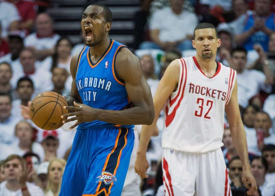 Thunder power forward Serge Ibaka celebrates after picking up a basket and a foul against Rockets guard Francisco Garcia.