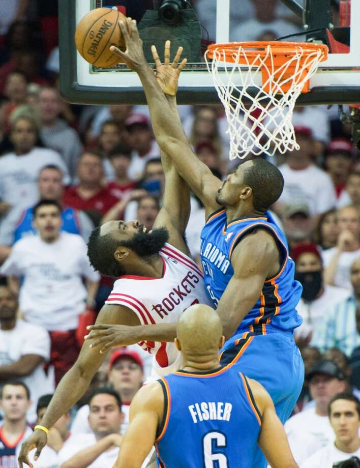 Rockets guard James Harden has his shot blocked by Thunder power forward Serge Ibaka.