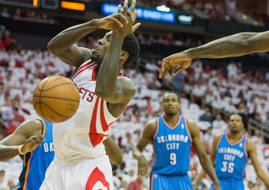 Rockets guard Patrick Beverley has the ball knocked away.