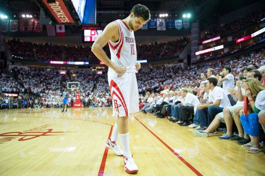 Rockets guard Carlos Delfino reacts after a basket by Thunder forward Kevin Durant with 41.9 seconds left.