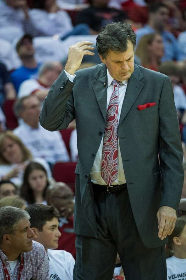Rockets head coach Kevin McHale scratches his head during the first half.