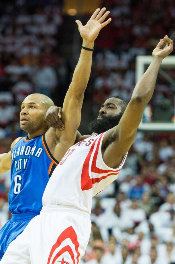 Rockets guard James Harden tangles with Thunder point guard Derek Fisher.