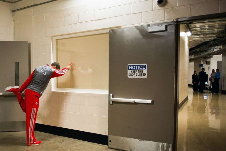 Rockets shooting guard Francisco Garcia stretches in the hallway outside the team locker room before Game 3.