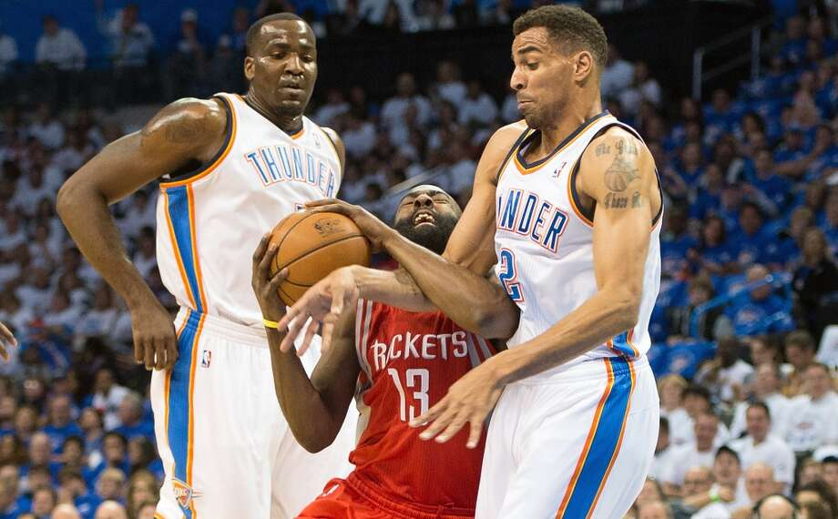 Rockets guard James Harden (13) is fouled by Thunder shooting guard Thabo Sefolosha (2) as center Kendrick Perkins (5) looks on.