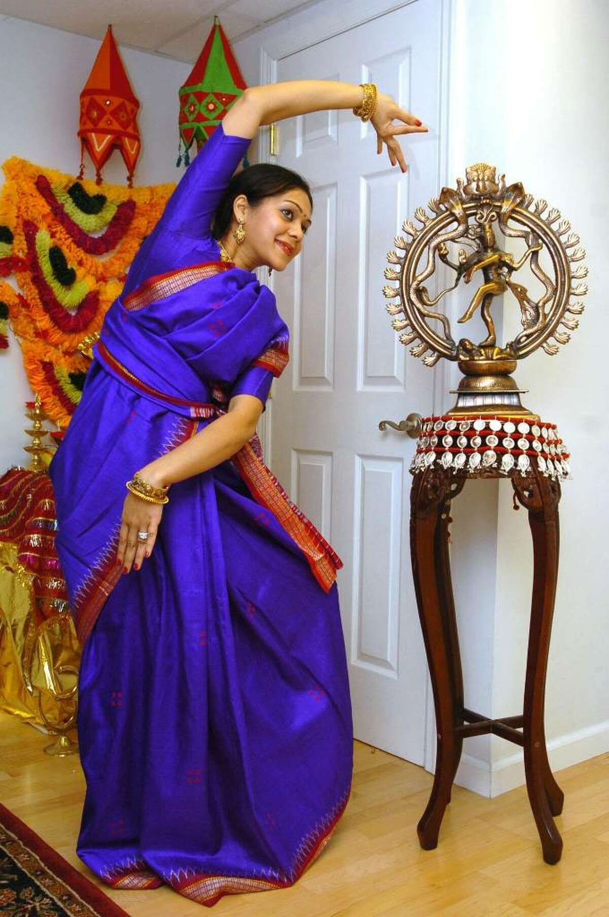 Anindita Nanda, of Danbury, photographed at her home practicing a form of dance called Odissi Classical in her pracitce Sari Thursday, Jan. 7, 2009.
