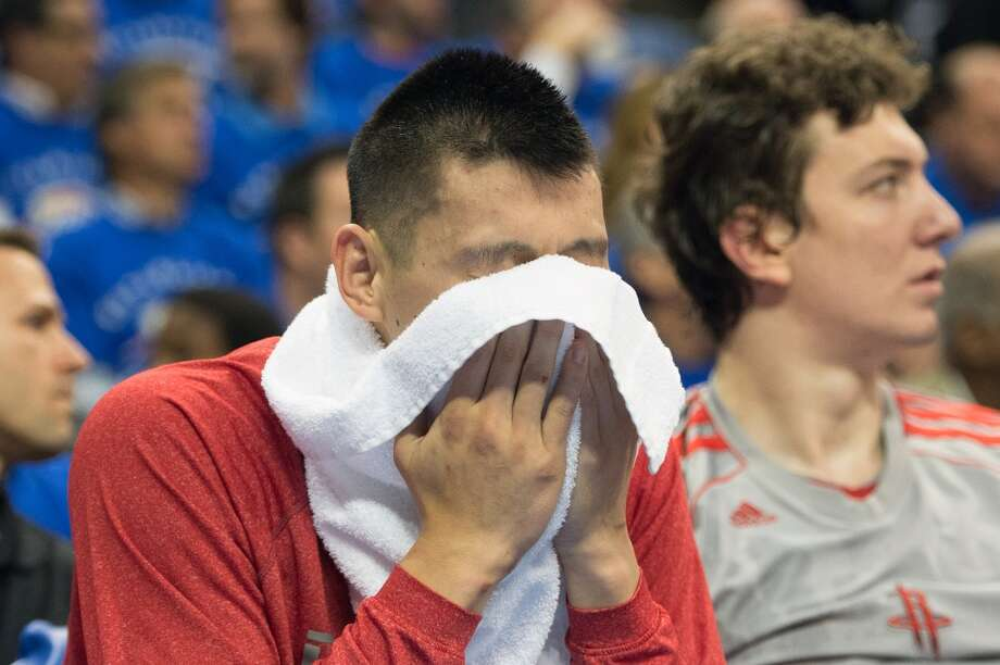 Rockets point guard Jeremy Lin sits on bench during the first half.