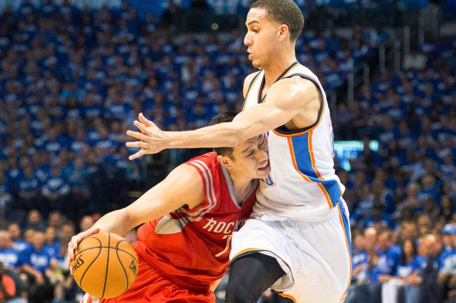 April 21: Thunder 120, Rockets 91 Rockets point guard Jeremy Lin collides with Thunder shooting guard Kevin Martin during the first half.Thunder lead best-of-seven series 1-0