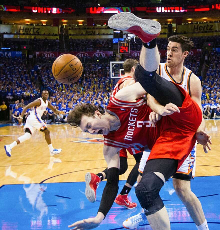Houston Rockets center Omer Asik is fouled by Oklahoma City power forward Nick Collison.