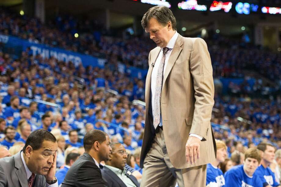 Houston Rockets head coach Kevin McHale and assistant coach Kelvin Sampson, left, react after a Thunder basket during the first half.