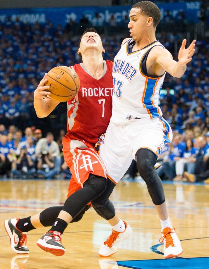 Rockets point guard Jeremy Lin (7) is fouled by  Thunder guard Kevin Martin.
