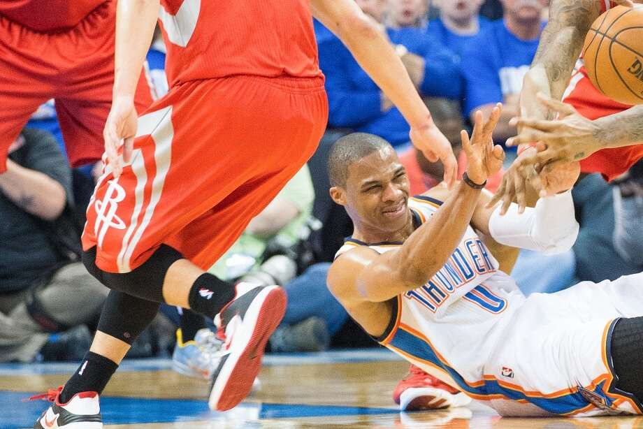 Thunder point guard Russell Westbrook fights for a loose  ball.
