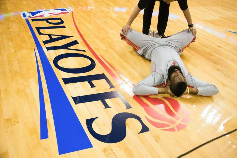 Rockets shooting guard James Harden stretches before Game 1.
