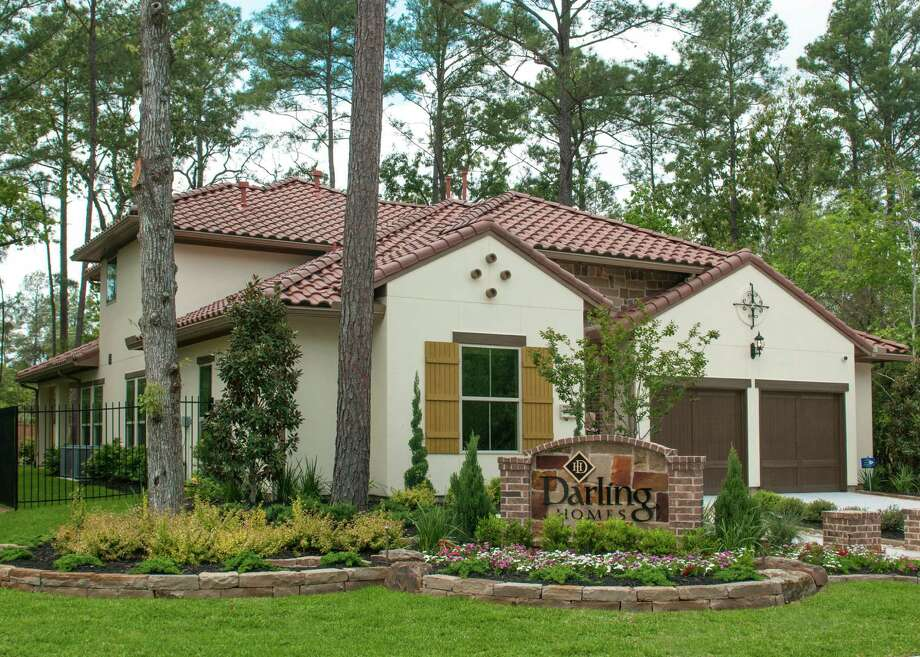 Darling Homes presents Plan 5142, a two-story patio home in the gated neighborhood of Timarron Lakes in The Woodlands' Village of Creekside Park. This home includes 2,882 square feet and is priced from $368,990. Photo: Ted Washington / Copyright©Ted Washington