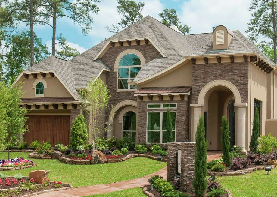 The Charleston design by J. Patrick Homes is offered in the neighborhood of Tannery Hill in The Woodlands' Village of Creekside Park. This two-story home includes 3,822 square feet, four bedrooms, 3½ baths and a three-car tandem garage with a portico. The Charleston is priced from $569,990. Photo: Ted Washington / Copyright©Ted Washington