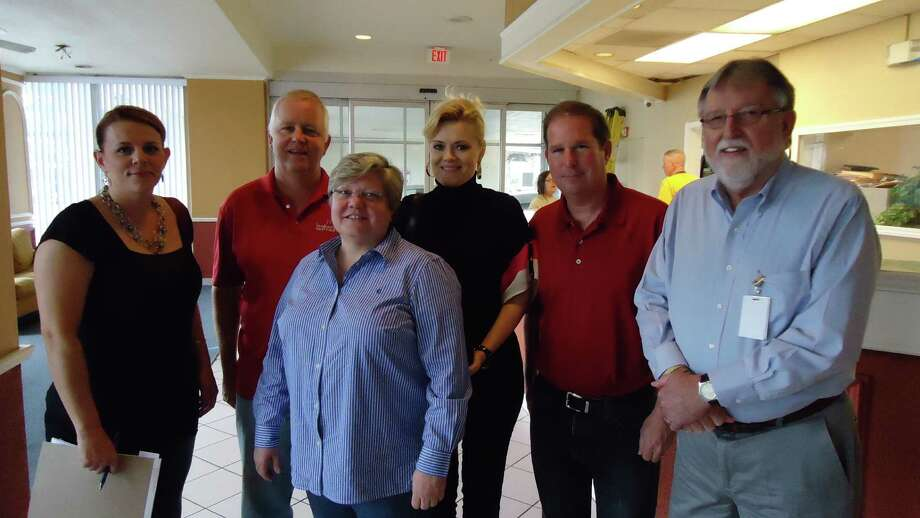 L to R:  Nicole Keown, Sandcastle Homes; MIke Dishberger, Sandcastle Homes; Leslie King, Greymark Construction; Lolita Guarin, Model Home Furniture of Katy; David Mandell, Cloudbreak Communities and Tom Mitchell, United States Veterans Initiative in the lobby of the U.S. Veterans Initiative Midtown facility as they prepare to begin remodeling.