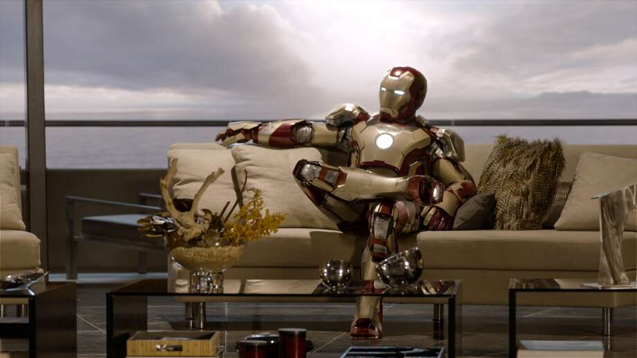 "This undated publicity photo released by Marvel shows Robert Downey Jr. as Tony Stark/Iron Man in a scene from Marvel's ""Iron Man 3."" The movie releases in the USA on May 3, 2013. (AP Photo/Marvel, Film Frame)"