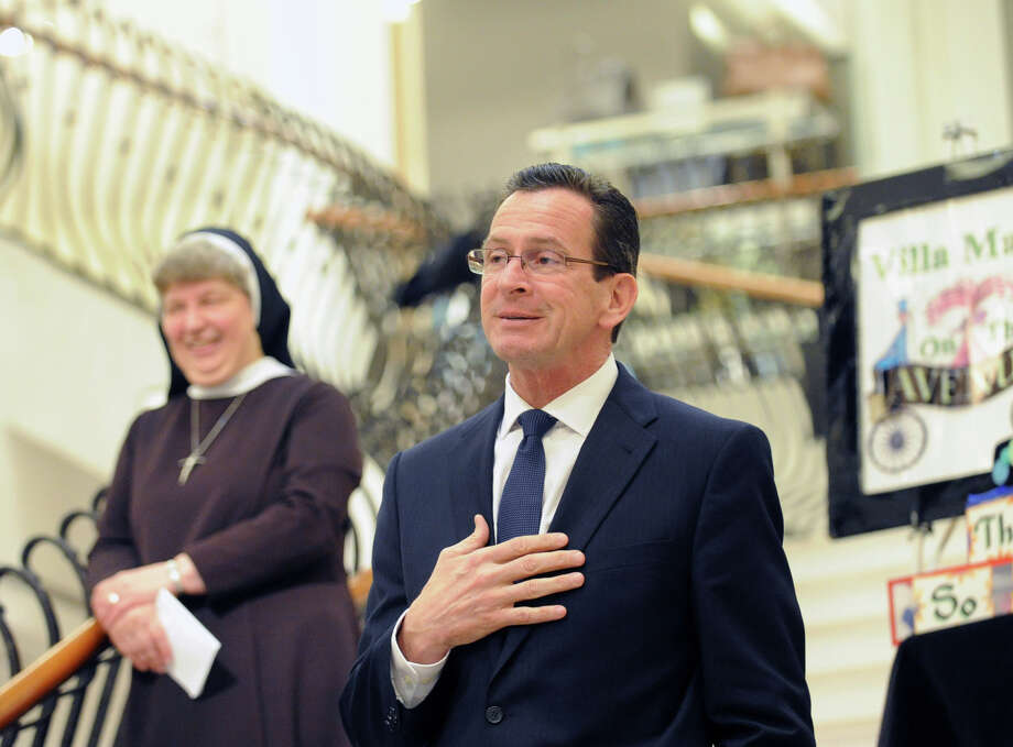 Governor Dannel P. Malloy will write a four-figure check to Time Warner Inc., reimbursing the corporation for travel, a hotel room and a seat at People Magazine's table during last week's glittery White House Correspondents' Dinner. Photo: Bob Luckey / Greenwich Time