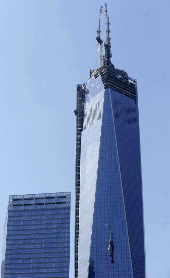 The top piece of the 408-foot spire for One World Trade Center is lifted to the top of the building in New York, Thursday, May 2, 2013. When it's fully installed, at a later date, it will top the building at a symbolic 1,776 feet. . Photo: Seth Wenig, AP / AP
