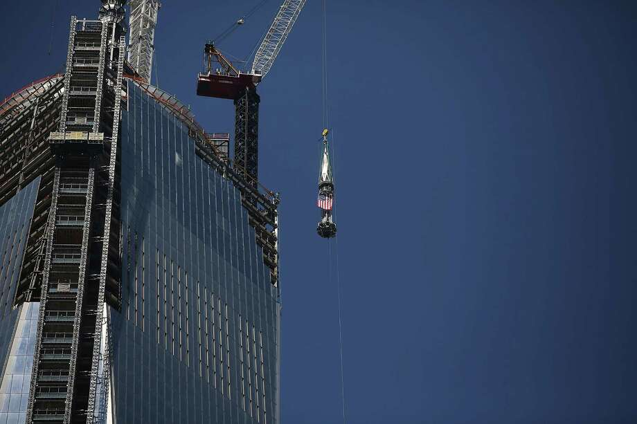NEW YORK, NY - MAY 02:  The 408-foot spire is hoisted onto a temporary platform on the top of One World Trade Center on May 2, 2013 in New York City. When bolted into place at a later date, the spire will make One World Trade Center the tallest building in the Western Hemisphere.The raising of the spire, which comes on the second anniversary of the death of Osama bin Laden, will make One World Trade Center 1,776 feet tall. One World Trade Center is built on the site where the September 11, 2001 attacks toppled the original World Trade Center towers. Photo: Spencer Platt, Getty Images / 2013 Getty Images