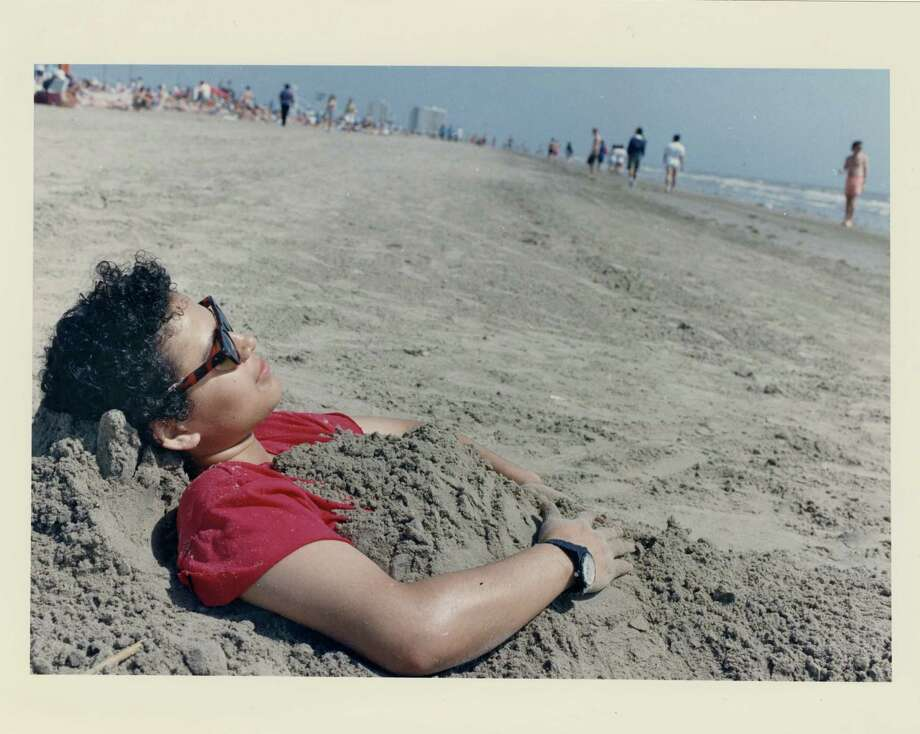 Spring breaker Ana Orellana of Houston found the Galveston sand to be just the right cover-up for today s bright skies. Near Stewart Beach. March 14, 1992 Photo: Manuel M. Chavez