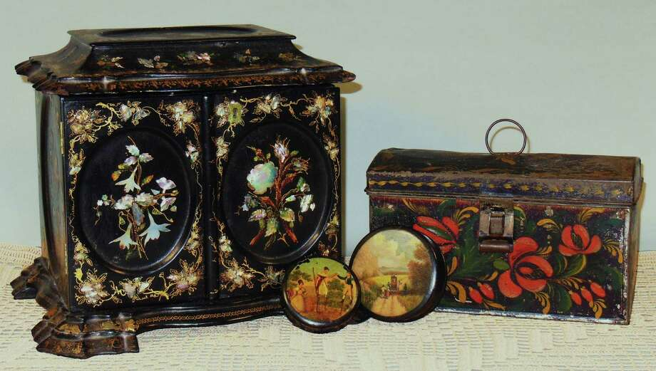 Historical Society of Early American Decoration displays 19th century antiques: a lady's cabinet for sewing and writing, two papier-mache Snuff boxes, and a New York style trunk. (Historical Society of Early American Decoration)