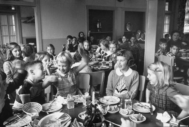 Children having lunch in Bush Parkside School cafeteria, 1954.  (Photo by Alfred Eisenstaedt//Time Life Pictures/Getty Images)