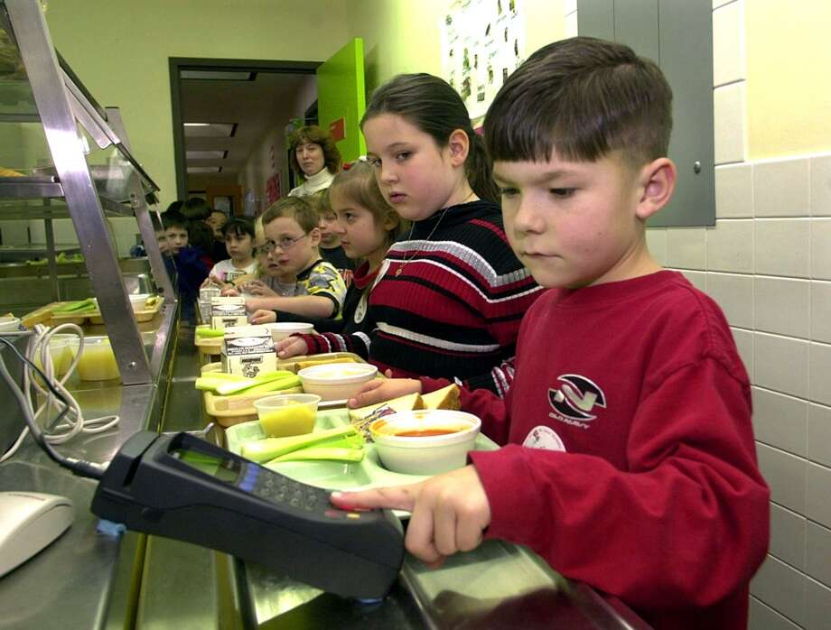 First-grader Brendan Eckenrode uses the fingerprint scanner to pay for lunch at Penn Cambria Pre-Primary School March 1, 2002 in Cresson, Pa. Penn Cambria is one of three school districts utilizing a biometric program from Food Service Solutions, in Altoona, PA that enables students to buy their lunch with their scanned fingerprints. (Photo by William Thomas Cain/Getty Images)