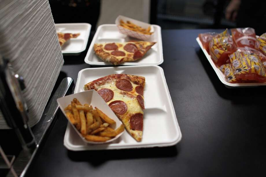 Pizza slices and french fries are seen as they are served during lunch at Everglades High School on November 18, 2011 in Miramar, Florida. Monday evening the United States Congress passed a spending bill with a provision that would allow schools to count pizza as a vegetable.  (Photo by Joe Raedle/Getty Images)