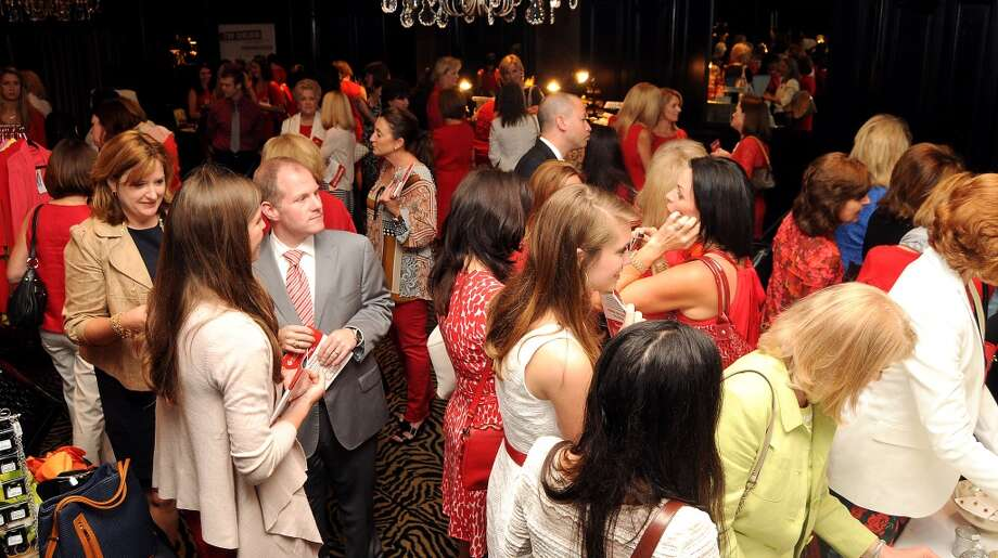 A full house at the American Heart Association's Go Red for Women Expo & Luncheon at the Hotel ZaZa
