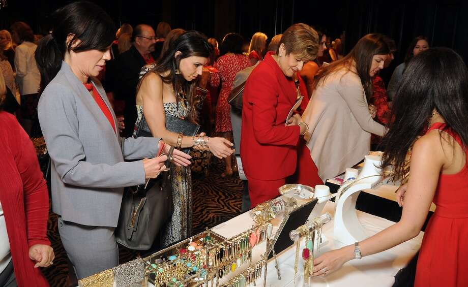 Women browse the jewelry for sale at the American Heart Association's Go Red for Women Expo & Luncheon at the Hotel ZaZa
