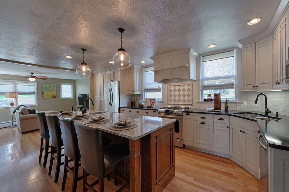 After photo of kitchen as designed by Nancy Moore for Millbrook Kitchens. Ceiling mural by Rae Rau for PaintFX. Photo: OEProPhoto / Optimum Exposure Photography