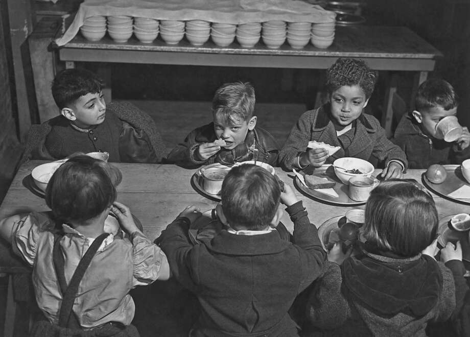 Children during their lunch period at a public school in New York City, May 1947. (Photo by Archive Photos/Getty Images)