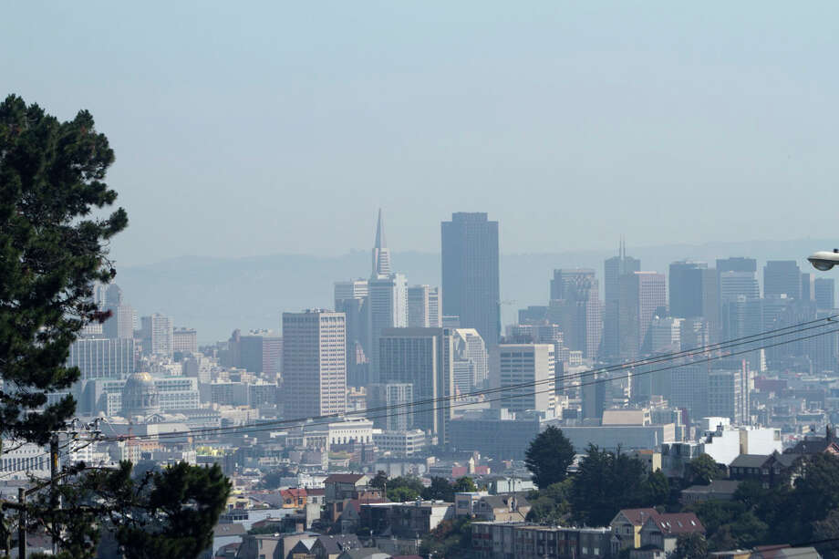 The San Francisco skyline is enveloped in a smoky haze Thursday morning. Visibility has been decreased as a result of the smoke, but a slight wind might push it inland this afternoon. Photo: SF Gate / Douglas Zimmerman