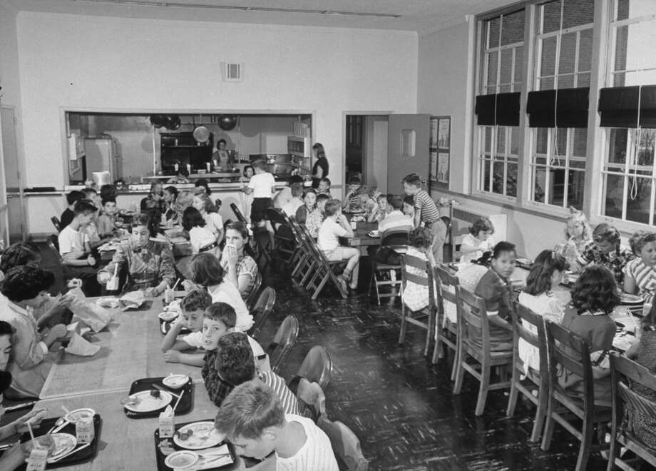 Children eating lunch in the school cafeteria in 1948.  (Photo by Bernard Hoffman//Time Life Pictures/Getty Images)