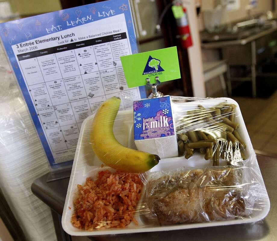 "A three entree elementary lunch lies on display in the Nettelhorst Elementary School lunchroom March 20, 2006 in Chicago, Illinois. U.S. Senator Dick Durbin (D-IL) stopped by the school to visit the new, pilot lunch program called, ""Cool Foods,"" as part of the Healthy Schools Campaign. Nettelhorst is one of three Chicago public schools participating in the new lunch program offering salad bars as a new federal law, effective June 30, 2006, states that all schools must establish wellness policies.  (Photo by Tim Boyle/Getty Images)"