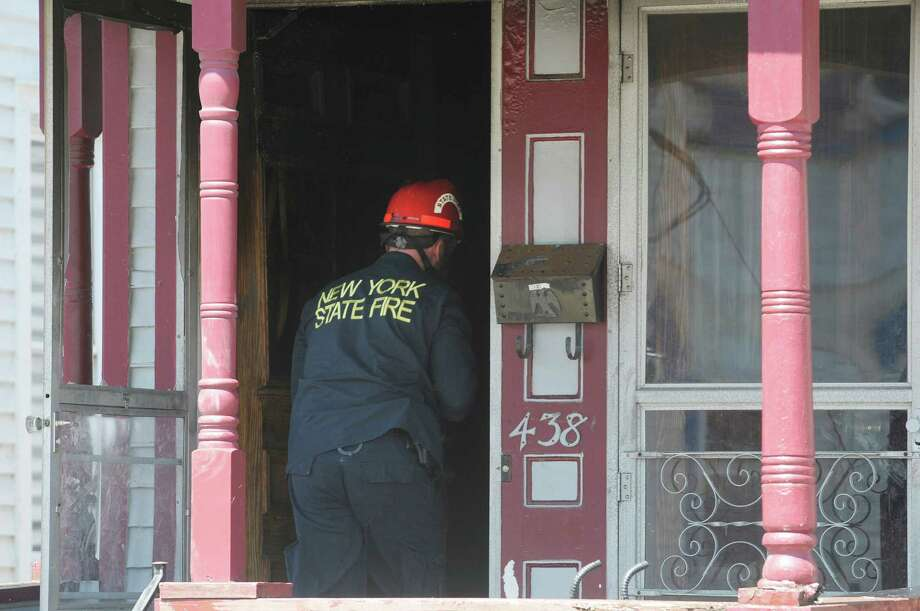 A fire investigator enters  the scene of a house fire at 438 Hulett St. on Thursday, May 2, 2013 in Schenectady, NY.  Police said that four of the five people pulled from a burning home early Thursday morning  have died.  Three children and one adult died.   (Paul Buckowski / Times Union) Photo: Paul Buckowski