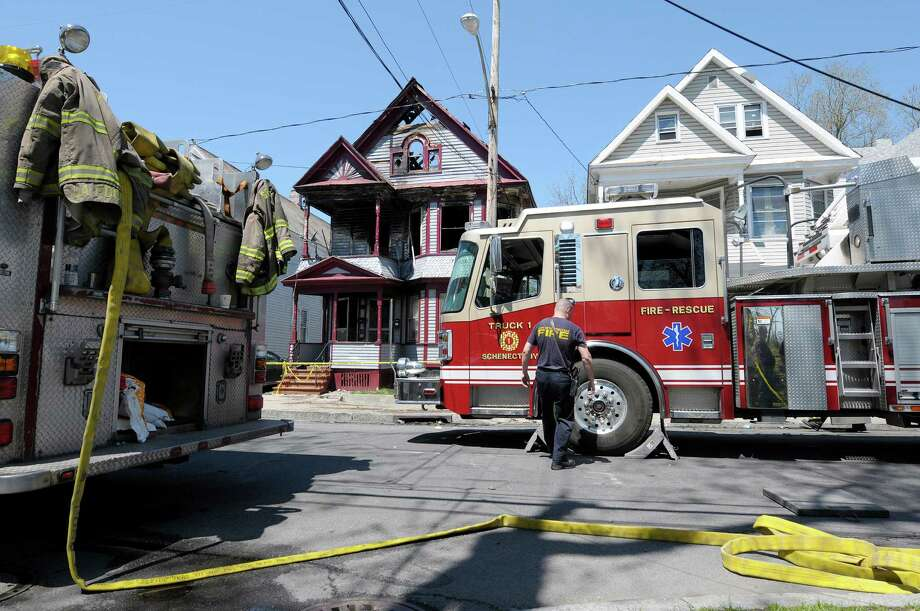 Firefighters at the scene of a house fire at 438 Hulett St. on Thursday, May 2, 2013 in Schenectady, NY.  Police said that four of the five people pulled from a burning home early Thursday morning  have died.  Three children and one adult died.   (Paul Buckowski / Times Union) Photo: Paul Buckowski