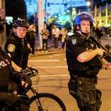 Police face off against demonstrators during a May Day protest in Seattle.
