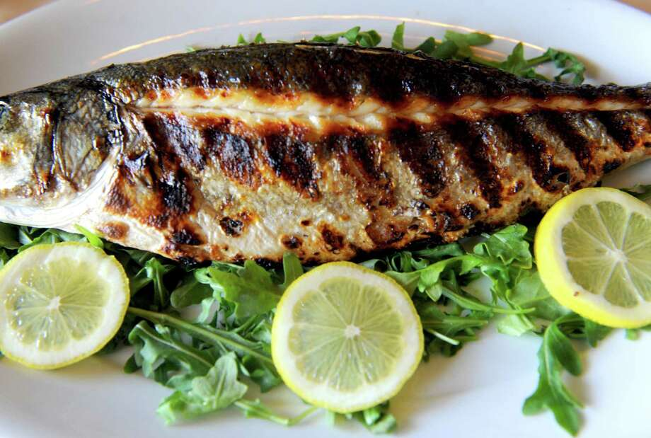 A Bronzini, whole grilled fish, at Athos Restaurant on Friday April 26, 2013 in Guilderland , N.Y. (Michael P. Farrell/Times Union) Photo: Michael P. Farrell