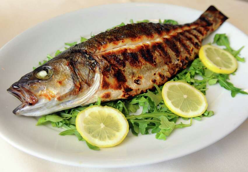 A Bronzini, whole grilled fish, at Athos Restaurant on Friday April 26, 2013 in Guilderland , N.Y. (Michael P. Farrell/Times Union)