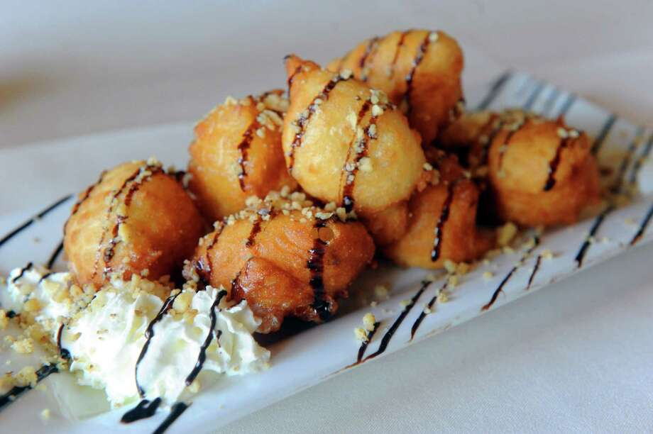 Loukomathes a fried dough stuffed with chocolate at Athos Restaurant on Friday April 26, 2013 in Guilderland , N.Y. (Michael P. Farrell/Times Union) Photo: Michael P. Farrell