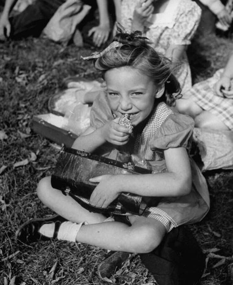 A little girl eating lunch outside at school in 1946.  Keep clicking for photos of school lunches then, and now. Photo: Bernard Hoffman, Time & Life Pictures/Getty Image / Time Life Pictures