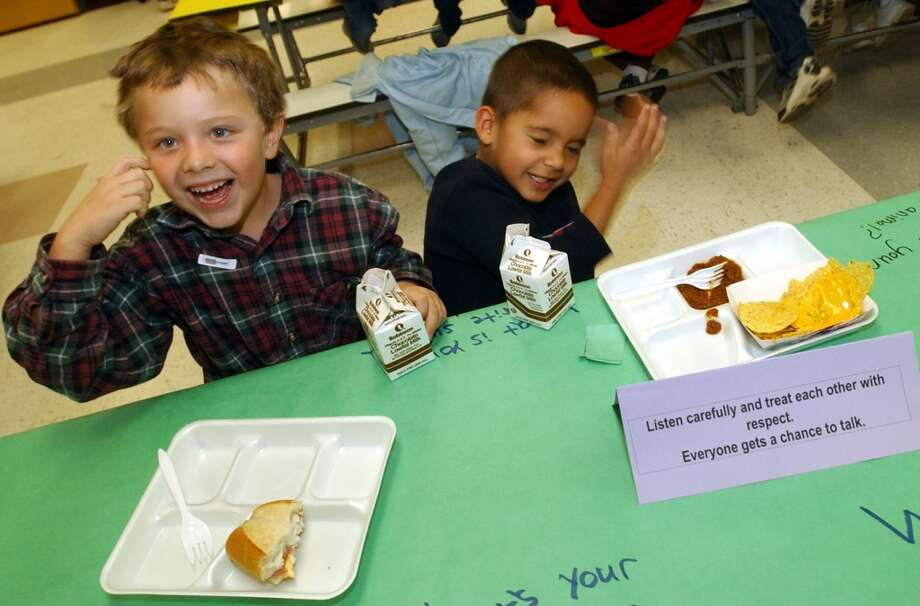 2003- Tanner Murray, 6, left, and Anthony Toscano, 5, of Allendale Elementary School are having lunch together.