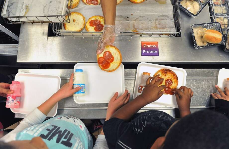 Children are served lunch at Broad Acres Elementary School on Tuesday December 18, 2012 in Silver Spring, MD.