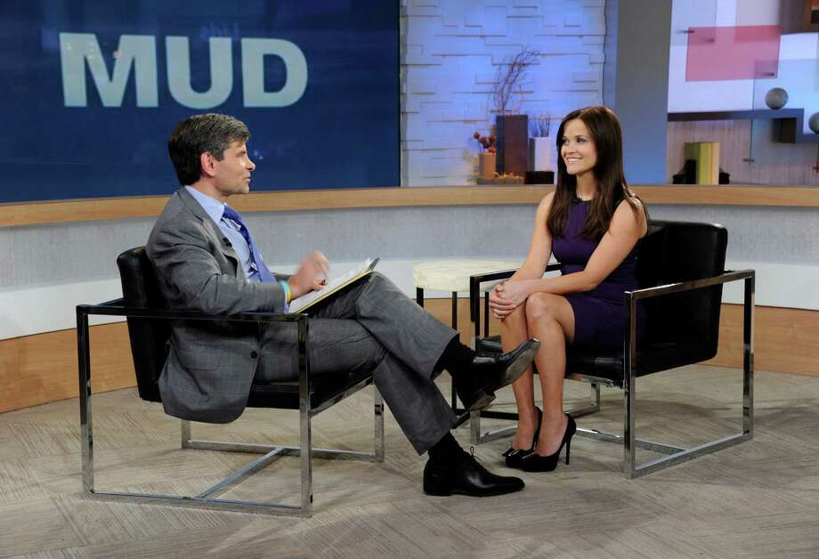 "This image released by ABC news shows co-host George Stephanopoulos, left, interviewing actress Reese Witherspoon on ""Good Morning America,"" Thursday, May 2, 2013 in New York. During the interview, Witherspoon repeatedly apologized for her behavior during an April 19 traffic stop in Georgia. Witherspoon, 37, was arrested after the trooper said she wouldn't stay in the car while her husband, Hollywood agent Jim Toth, was given a field sobriety test. Toth was charged with drunken driving and is due in court May 23. Witherspoon faces a May 22 court hearing on the disorderly conduct charge. (AP Photo/ABC, Ida Mae Astute) Photo: Ida Mae Astute"