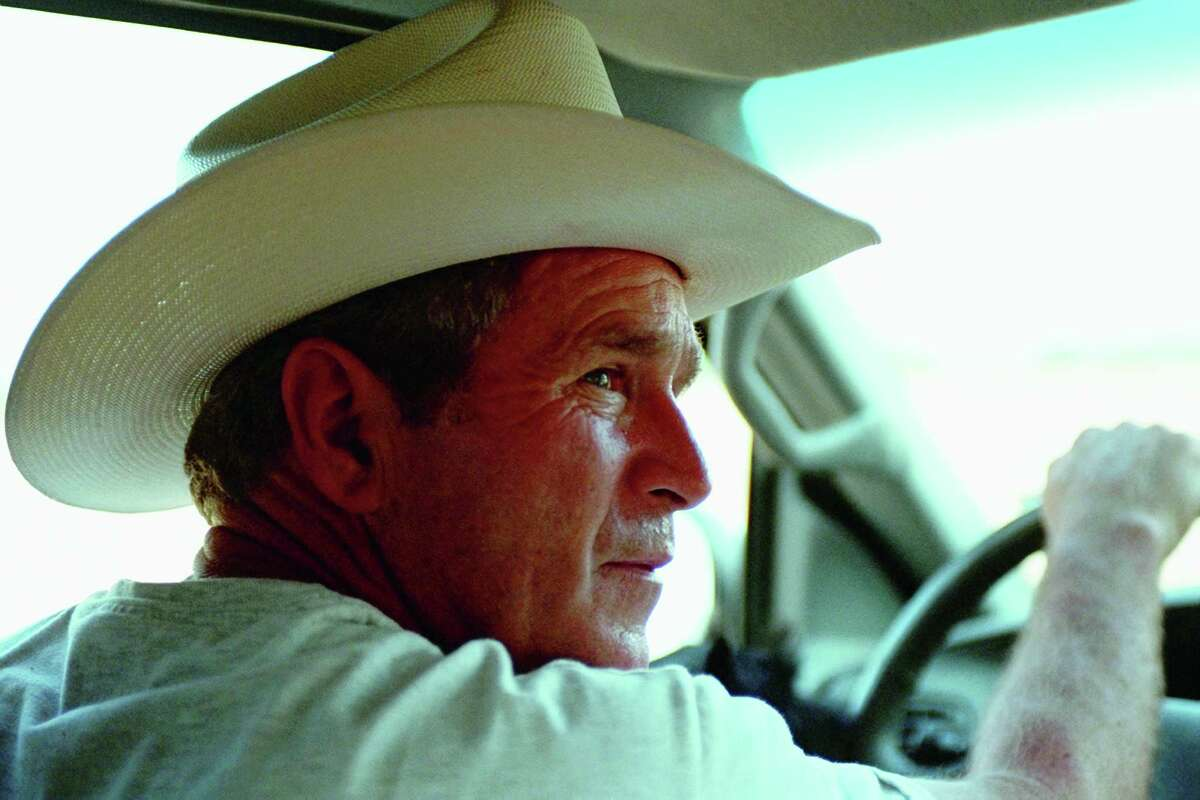 """Eric Draper considers this his favorite photo he took of George W. Bush. """"I go back to the cowboy hat in Crawford, Texas ... it captures his spirit,"""" Draper says."""