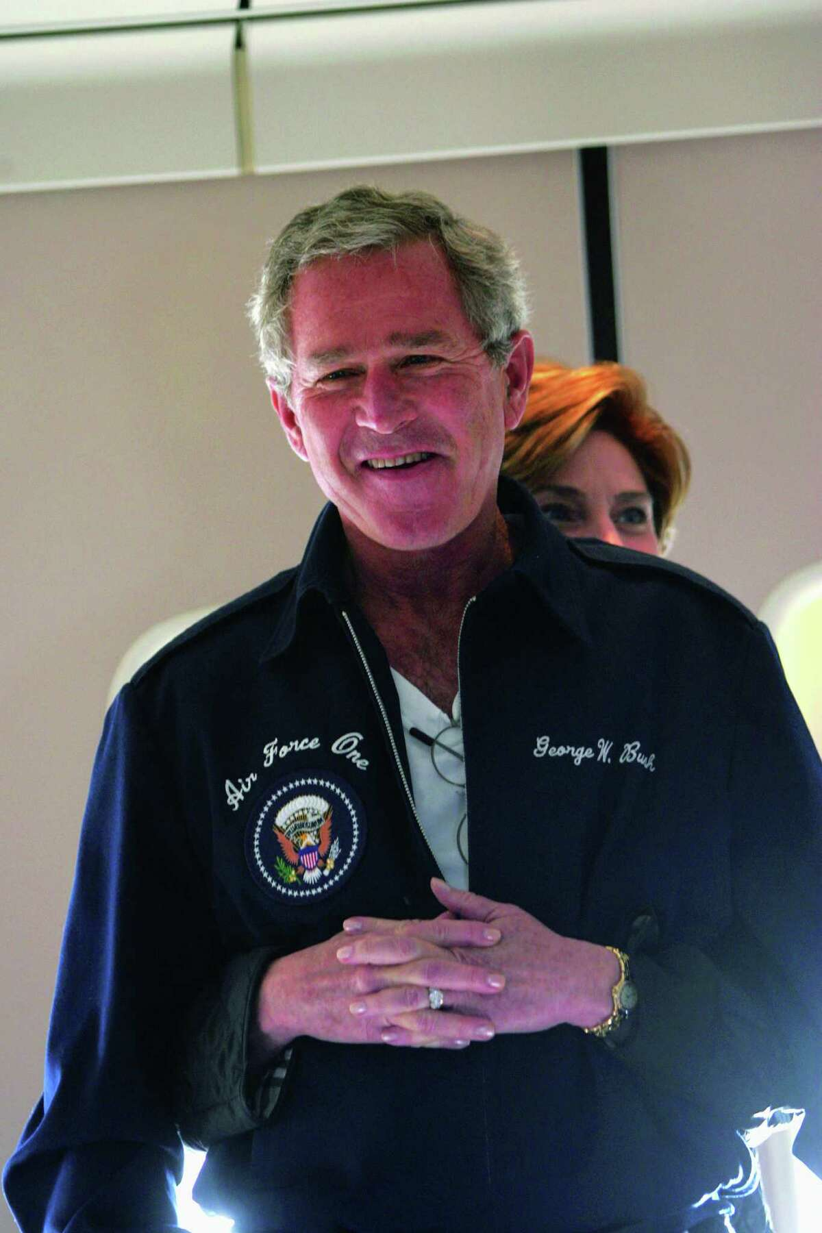 President George W. Bush and Mrs. Laura Bush spend a light-hearted moment together aboard Air Force One Friday, Oct. 15, 2004, en route to Iowa. Photo by Eric Draper, Courtesy of the George W. Bush Presidential Library and Museum