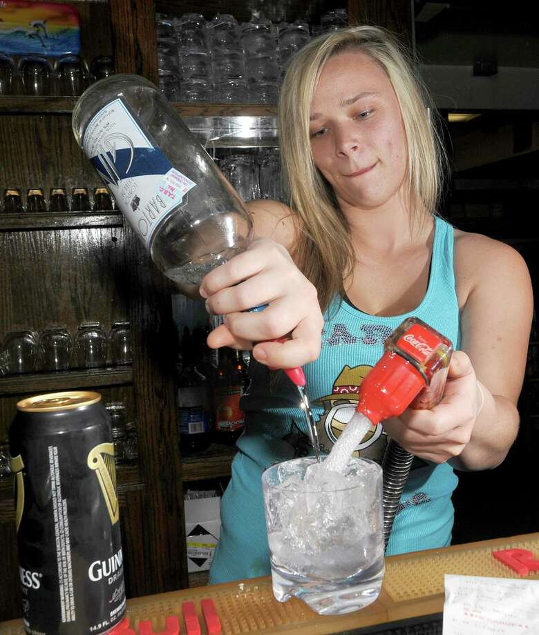 Caitlin Callicutt is a bartender at Starvin Marvin's in Beaumont.  She is the Cat 5 Bartender of the Week for the May 2, 2013 issue.  Dave Ryan/The Enterprise Photo: Dave Ryan