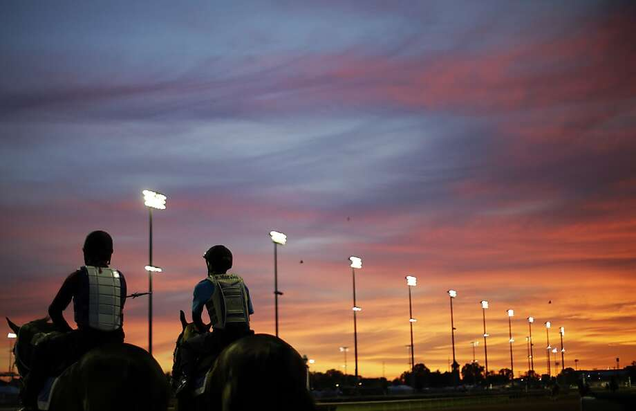 Derby day approaches:Riders get ready for their morning workouts at Churchill Downs in Louisville, Ky. Photo: David Goldman, Associated Press